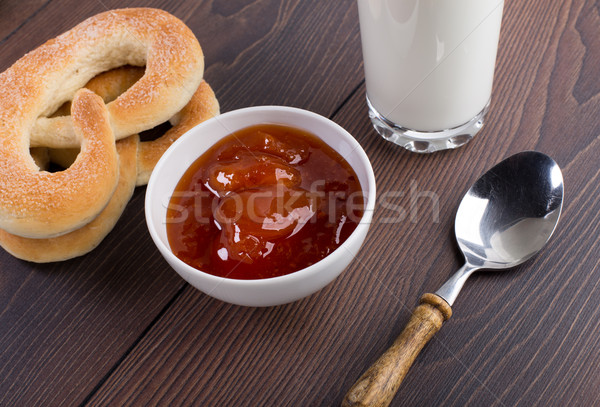 Soft pretzels, apricot jam and glass of milk Stock photo © vankad