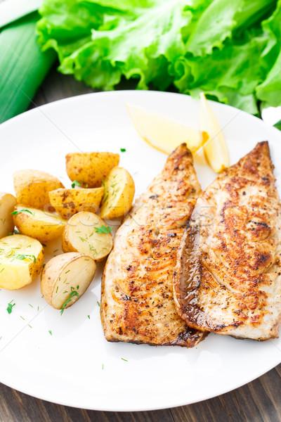 Fried mackerel with baked potato Stock photo © vankad