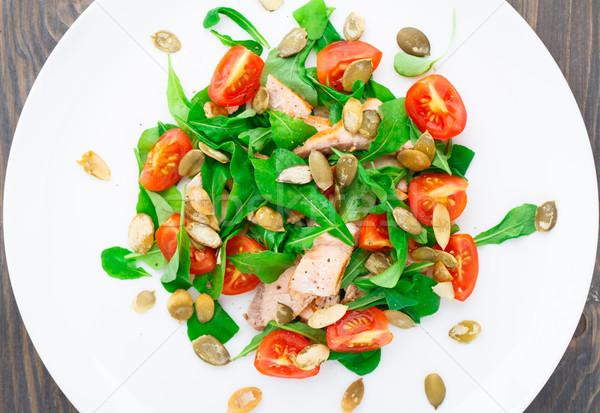 Salad with arugula, salmon and cherry tomato Stock photo © vankad