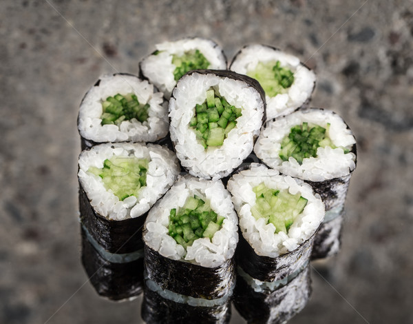 Stock photo: Mini roll with cucumber