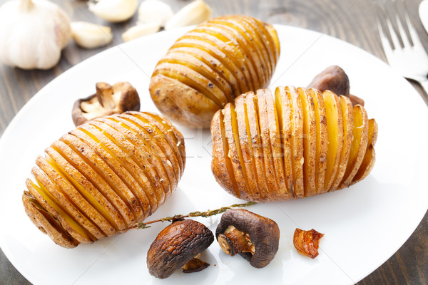 Stock photo: Accordion baked potatoes