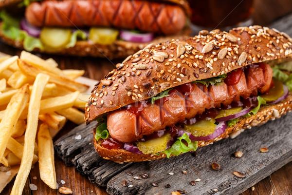 Barbekü ızgara sosisli sandviç patates kızartması akşam yemeği kırmızı Stok fotoğraf © vankad