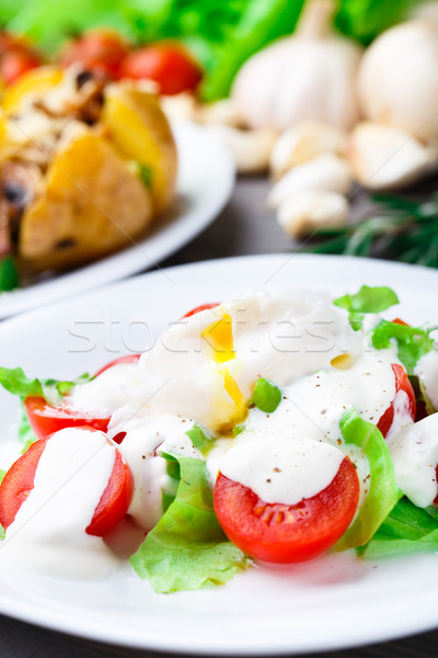 Vegetable salad with poached egg Stock photo © vankad