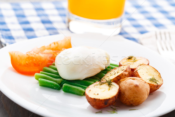 Poached egg with french beans and baked potato Stock photo © vankad