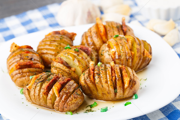 Accordion baked potatoes with bacon Stock photo © vankad