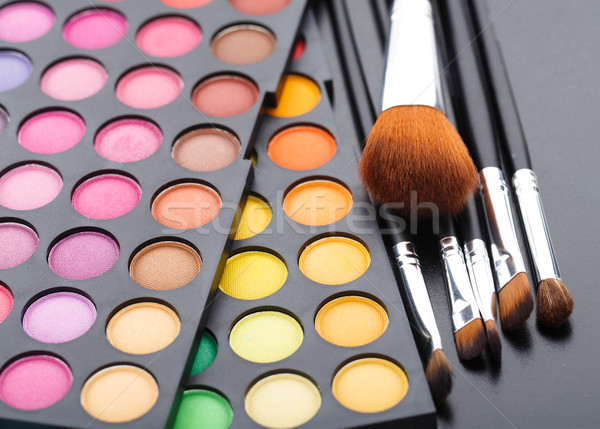 Stock photo: Makeup brushes and shadows