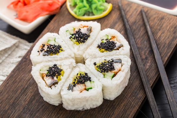 Flower made of sushi roll. Stock photo © vankad