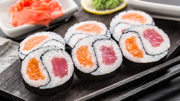 Yin yang futomaki with tuna and salmon Stock photo © vankad