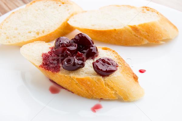 Tranche baguette cerise confiture plaque pain Photo stock © vankad