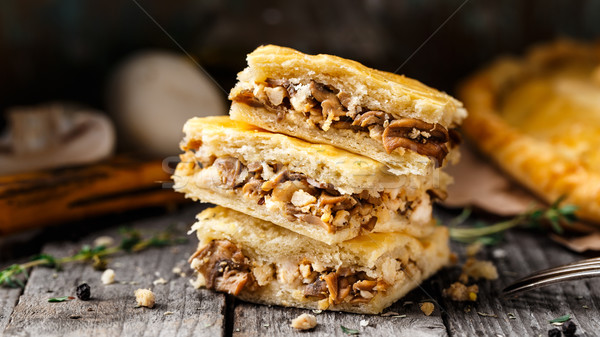 Homemade pie stuffed with mushrooms Stock photo © vankad