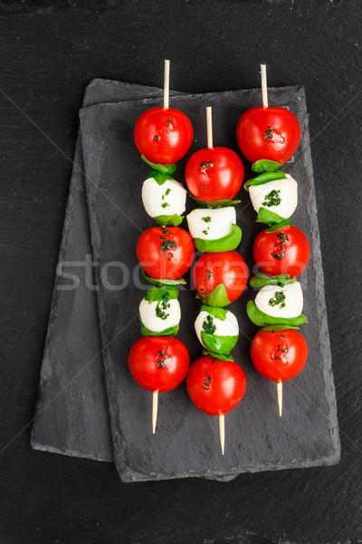 Caprese salatası siyah gıda yaprak arka plan kırmızı Stok fotoğraf © vankad