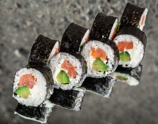 Sushi roll with salmon, cream cheese and avocado Stock photo © vankad