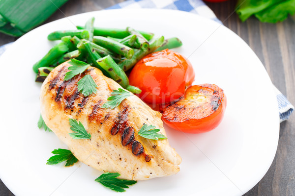 Grilled chicken with green beans and tomatoes Stock photo © vankad