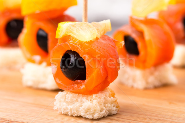Canape with salmon and olive Stock photo © vankad