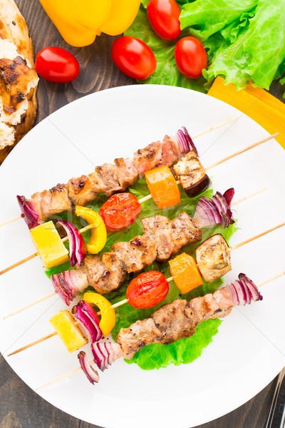Barbecued pork and vegetable kebabs Stock photo © vankad