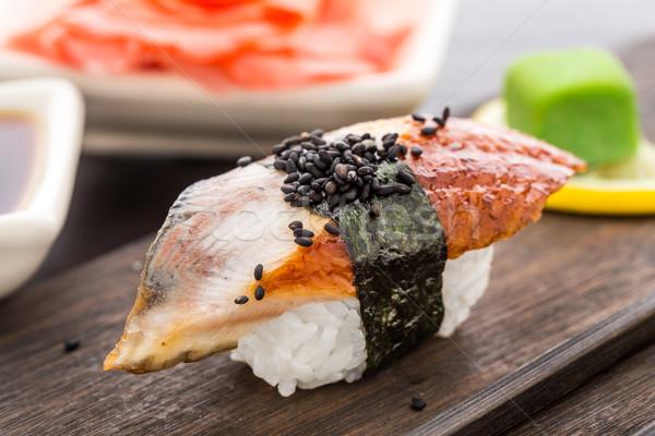 Sushi affumicato anguilla legno piatto alimentare Foto d'archivio © vankad