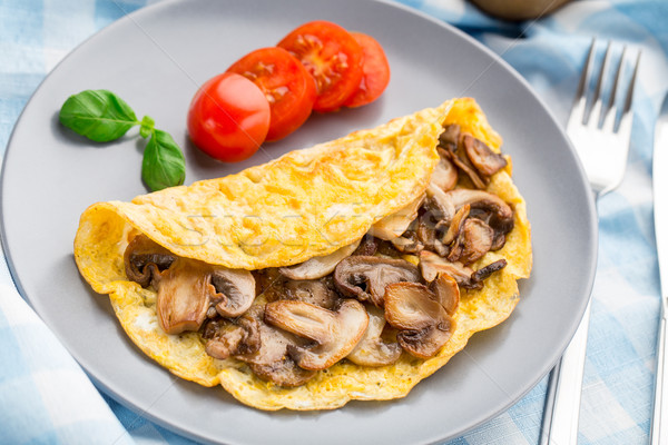 Omelette with mushrooms Stock photo © vankad