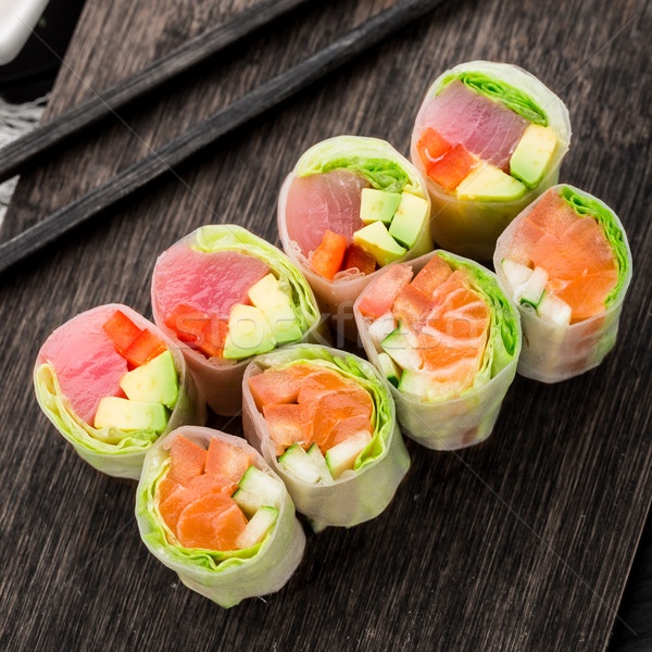 Spring rolls with tuna and salmon Stock photo © vankad