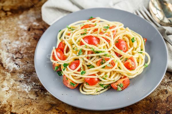 Pasta kerstomaatjes peterselie spaghetti achtergrond olie Stockfoto © vankad