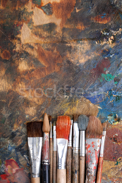 Abstract background with paint brushes Stock photo © vankad