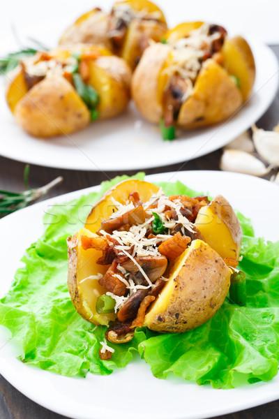 Baked potato with bacon and mushrooms Stock photo © vankad