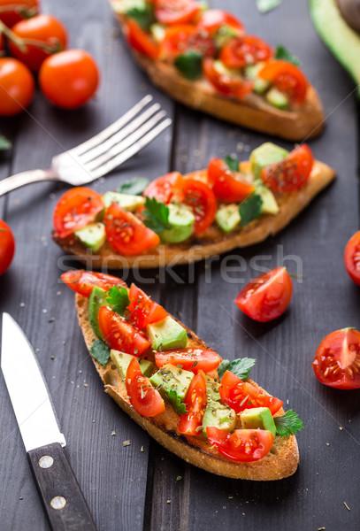 Stock photo: Bruschetta with tomato, avocado and herbs