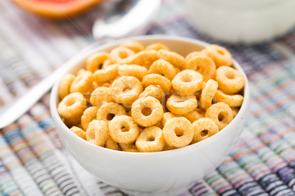 Stock photo: Bowl of honey corn rings