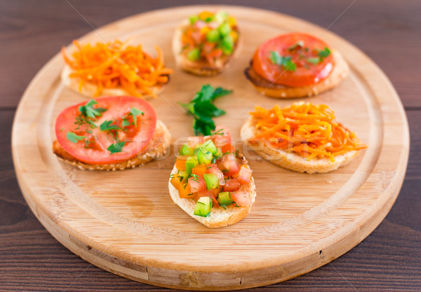 Delicious bruschetta with vegetables and herbs Stock photo © vankad