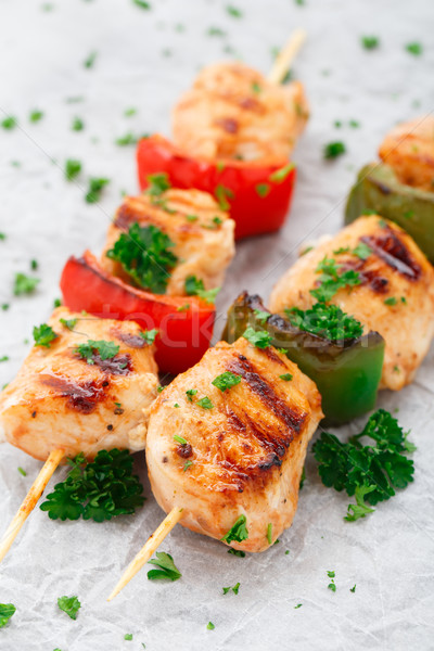 Grilled chicken skewers with paprika Stock photo © vankad