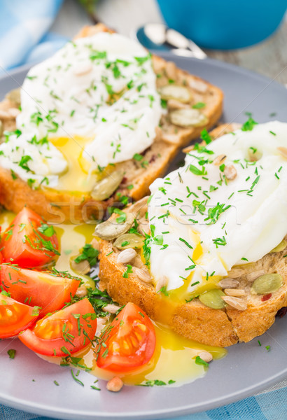 Sandwich with poached egg and cherry tomatoes Stock photo © vankad