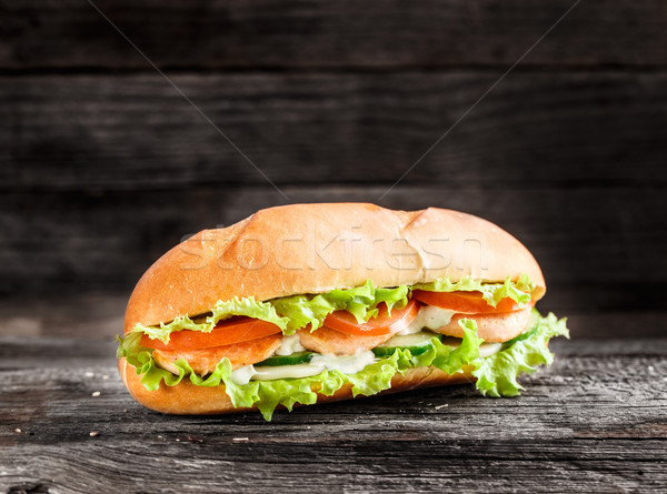 Sandwich with salmon patty and vegetables Stock photo © vankad