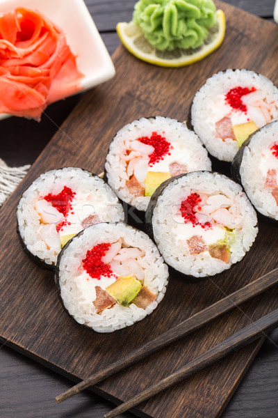 Sushi rolls with tobiko and shrimps Stock photo © vankad