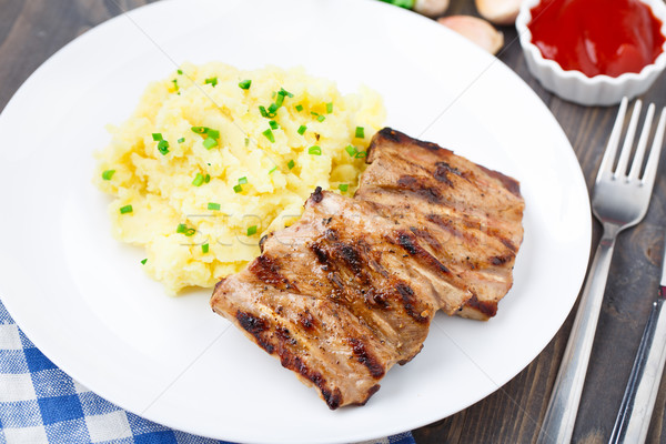 Grilled ribs with mashed potato Stock photo © vankad