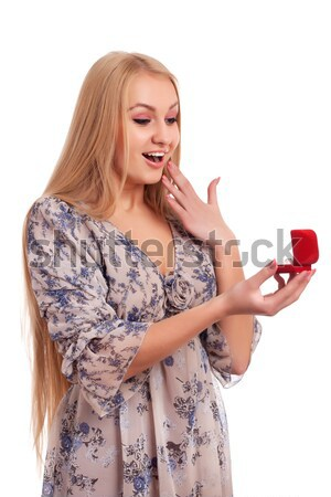 Woman looking at engagement ring in a box Stock photo © vankad