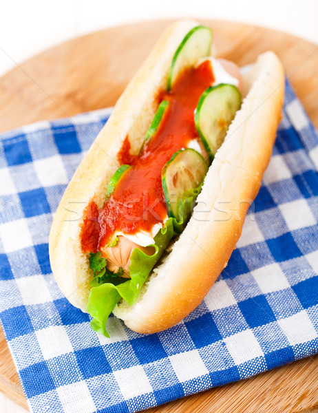 Hot dog with ketchup and cucumbers Stock photo © vankad