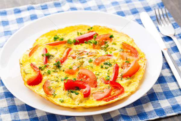 Omelet with paprika, tomato and herbs Stock photo © vankad