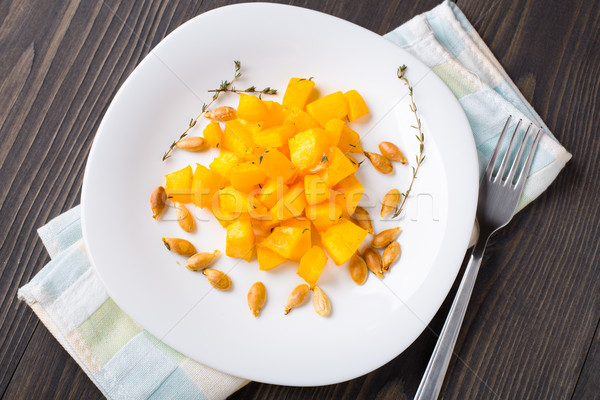 Baked pumpkin with olive oil and thyme Stock photo © vankad