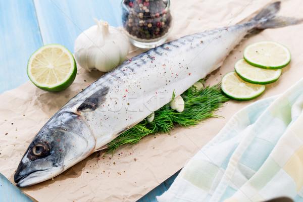 Fresh mackerel stuffed with dill and garlic Stock photo © vankad