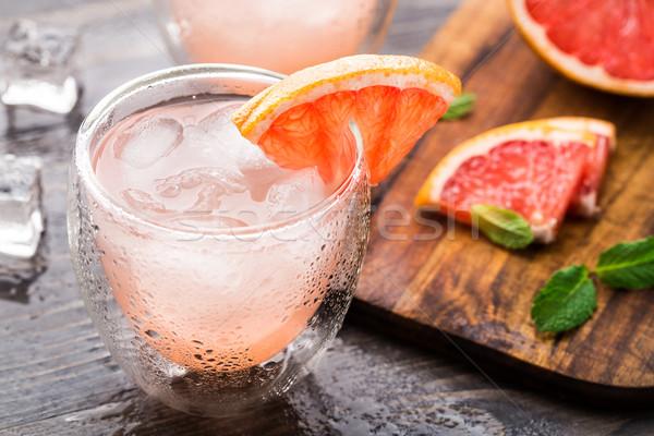 Grapefruit koktél szelet fa asztal víz zöld Stock fotó © vankad