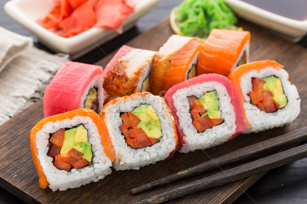Rainbow sushi roll with salmon, tuna and eel Stock photo © vankad