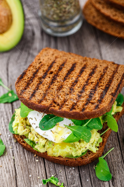 Sandwich with avocado and poached egg Stock photo © vankad