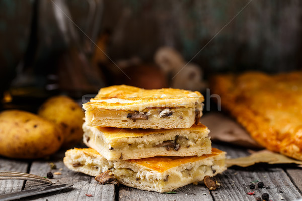 Homemade pie stuffed with potato and mushrooms Stock photo © vankad