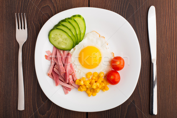 Fried egg with vegetables and ham Stock photo © vankad
