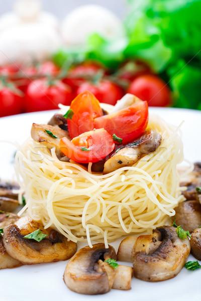 Pasta with cherry tomato and mushrooms Stock photo © vankad
