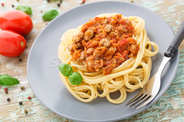 Spaghetti bolognese with basil leave Stock photo © vankad