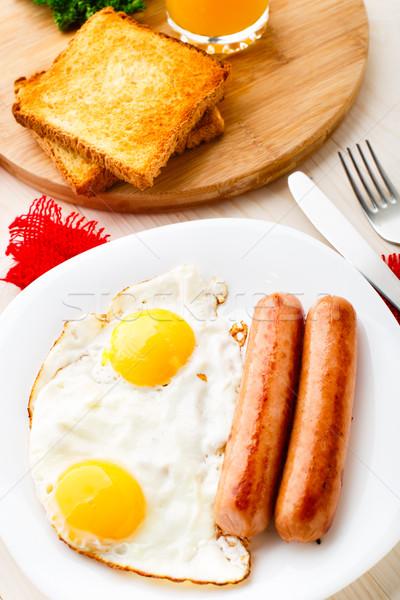 Сток-фото: жареный · яйца · пластина · оранжевый · пить