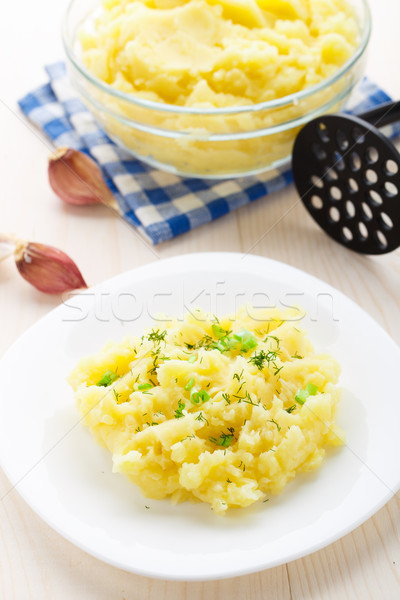 Mashed potatoes sprinkled with scallion and dill Stock photo © vankad