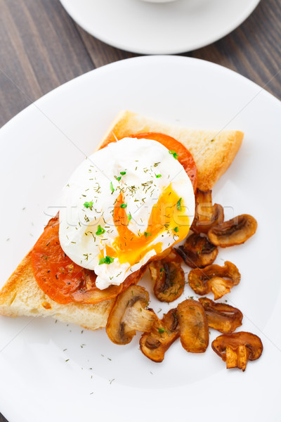 Poached egg with mushrooms and tomatoes Stock photo © vankad