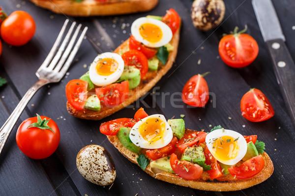 брускетта томатный авокадо яйцо деревянный стол красный Сток-фото © vankad