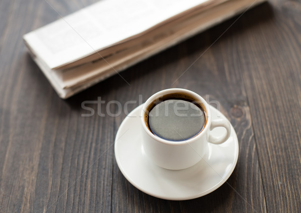 Newspaper and cup of coffee on table Stock photo © vankad